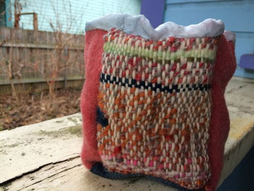 Basket with woven panel